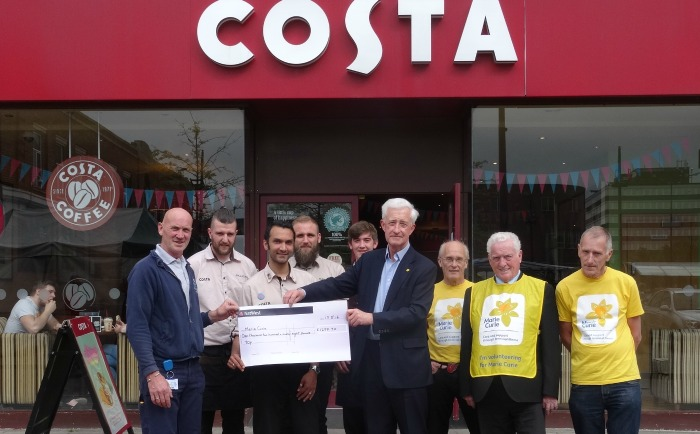 Halloween house fundraiser - Richard and James Stack present the cheque to Chris Barratt