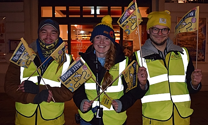 Rickshaw Challenge team prepare to handout welcome flags in Memorial Square (2)