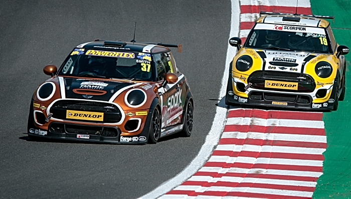 Rob Smith battles for position in MINI Challenge
