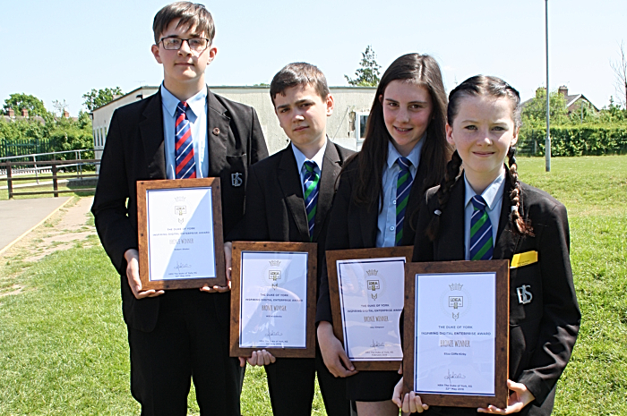 Robert Shuker, Will Maddocks, Izzy Simpson and Eliza Cliffe-Kirby proudly show their new certificates