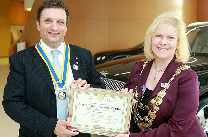 Rotary Club of Bentley Cheshire President Carlos Costa is presented with the official Charter by President of Rotary International Great Britain and Ireland, Eve Conway