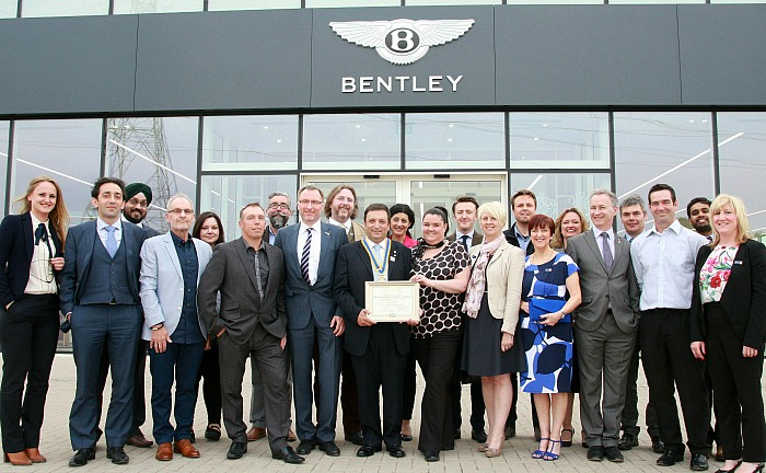 Rotary Club of Bentley Cheshire members are seen at the Charter presentation at the car showroom in Crewe