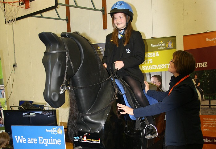 careers - Ruby Parsons gets the chance to 'experience' horse riding watched over by Dawn Joyce a member of the Reaseheath College Equine Staff