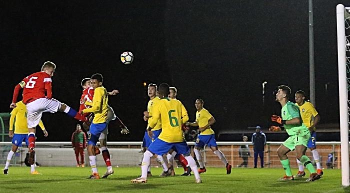 Russia captain Litvinov Ruslan heads the ball towards the Brazil goal