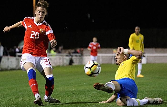 Russia player Faizullin Denis crosses the ball