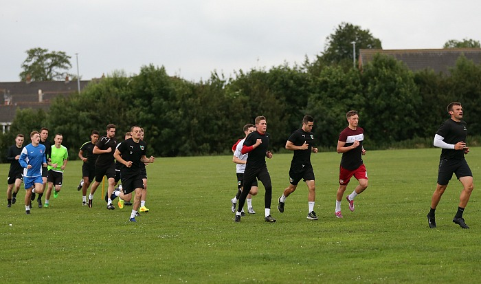 training - Sam Hall leads the way in a warm up run