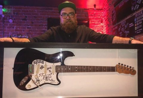 Crewe and Nantwich bar firm to raffle off Buzzcocks guitar in aid of Foodbank