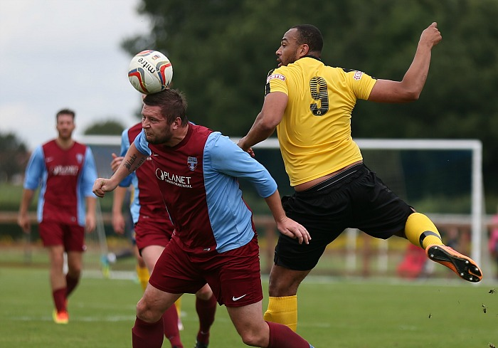 Sandbach player wins the ball from Clayton McDonald