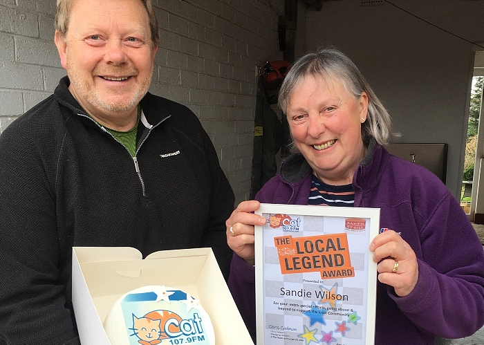 Sandie Wilson is pictured with her Cat Cake and Local Legend award certificate with her husband Mark (1)