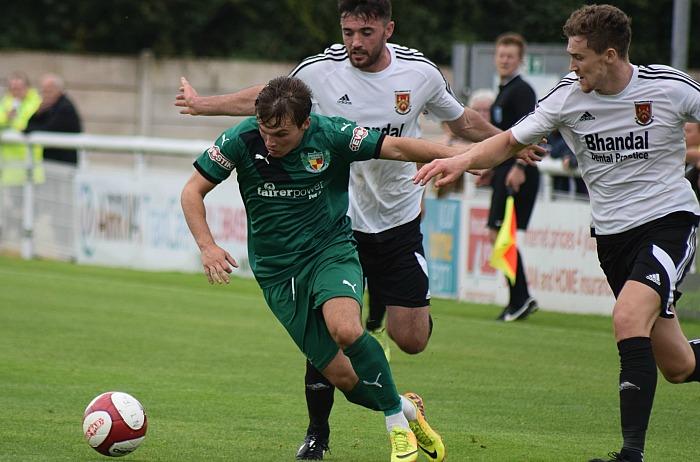 Warrington win - Sean Cooke battles past two Stourbridge defenders