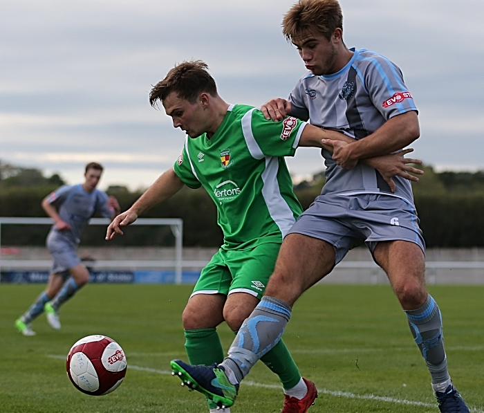 Sean Cooke fights for the ball (1)