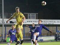 Second-half - Connor Heath rises to win the ball