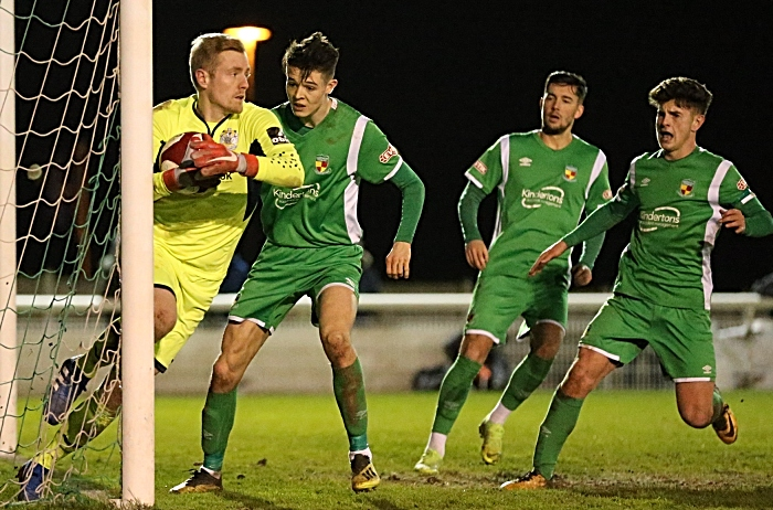 Second-half - Dabbers players pressurise Stockport keeper Ian Ormson (1)