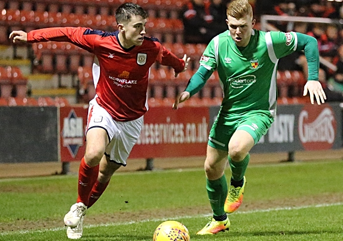 Second-half - Danny Glover puts pressure on Crewe Alex player (1)