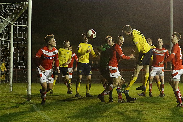 Second-half-David Forbes heads at goal