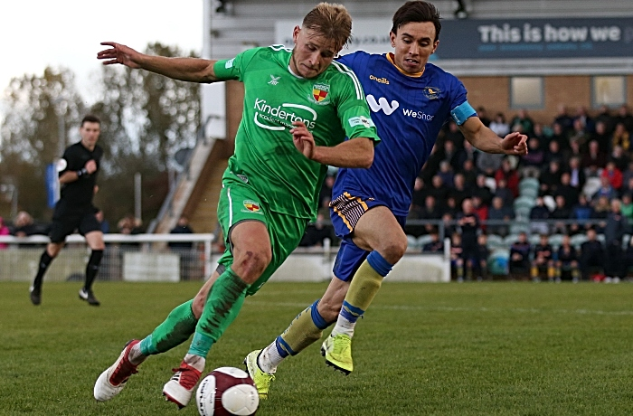 Second-half - David Webb goes forward under pressure from King's Lynn captain Michael Clulan (1)