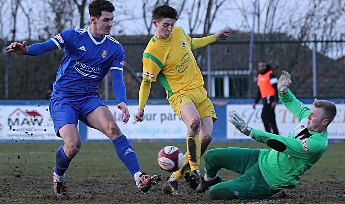 Second-half - Farsley Celtic keeper Kyle Trennery blocks the ball under pressure from Joe Malkin