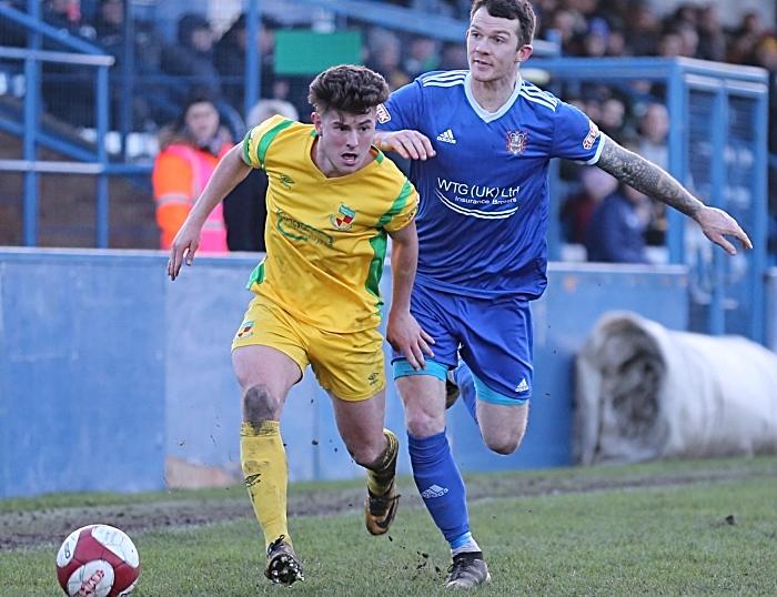 Second-half - Jamie Morgan holds the ball under pressure