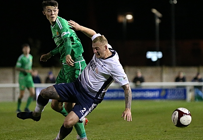Second-half - Joe Malkin challenges for the ball (1)