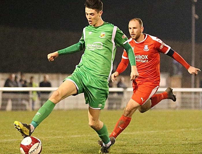 Second-half - Joe Malkin controls the ball under pressure (1)