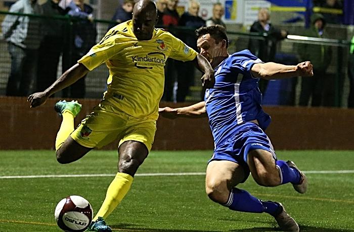 Second-half - Joe Mwasile crosses the ball under pressure (1)