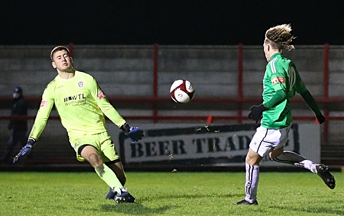 Second-half - fifth Nantwich goal - Luke Walsh lifts the ball over the rushing keeper