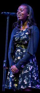 Sinead performing in Open Mic UK