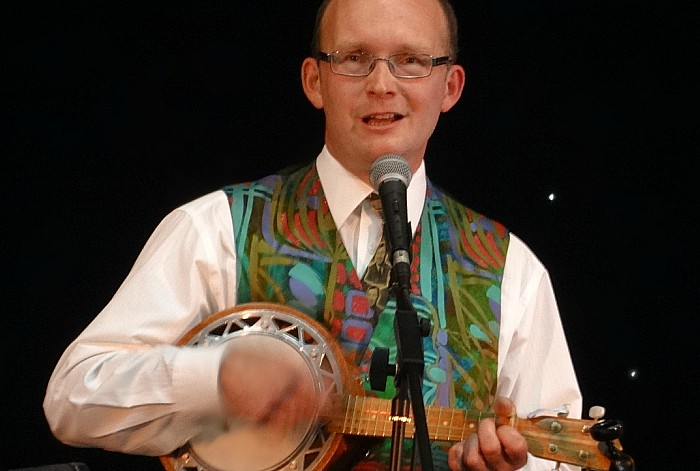 Society member Chris White performs at a South Cheshire George Formby Ukulele Society concert