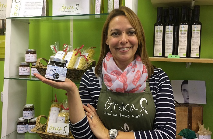 Greek woman Sofia of Greka Foods with award-winning product