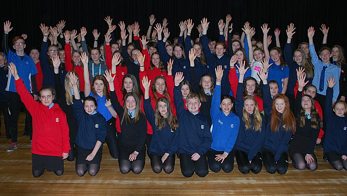 Some of the 120 students involved in the production practise for the curtain call