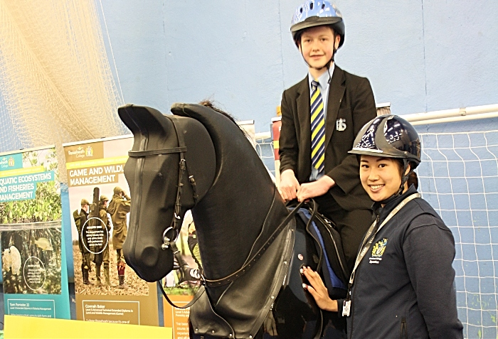 Careers - Sophie Chui Chi Lai, a technician from Reaseheath College Equestrian department, prepares to let Jack Marshall experience the thrills of horse riding