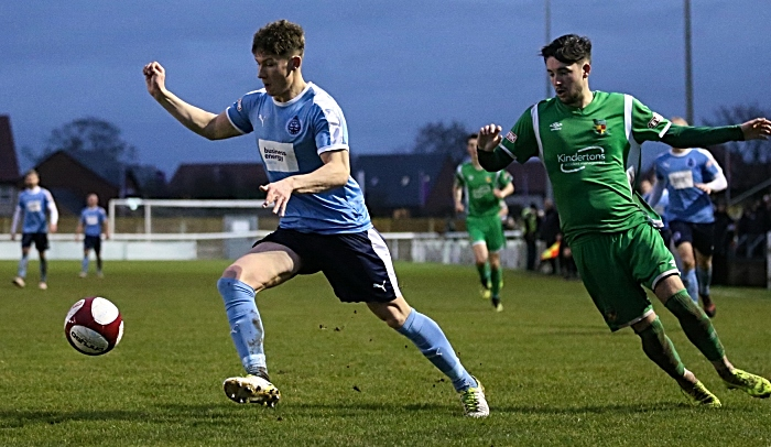 South Shields look to control the ball under pressure from Callum Saunders (1)