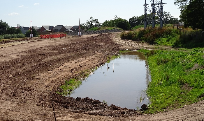 Spine road-bypass adjacent to River Weaver - section holding rainwater (1)