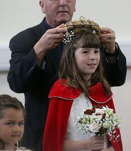 St. Mary's Wistaston Rector Mike Turnbull places the crown on this year's Rose Queen Charlotte Shaw (1)