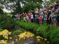 Villagers enjoy annual duck race in Wistaston