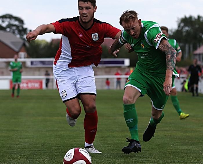 Steve Jones challenges for the ball (1)