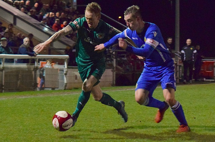Steve Jones fights for the ball - Nantwich reach Cheshire Senior cup final