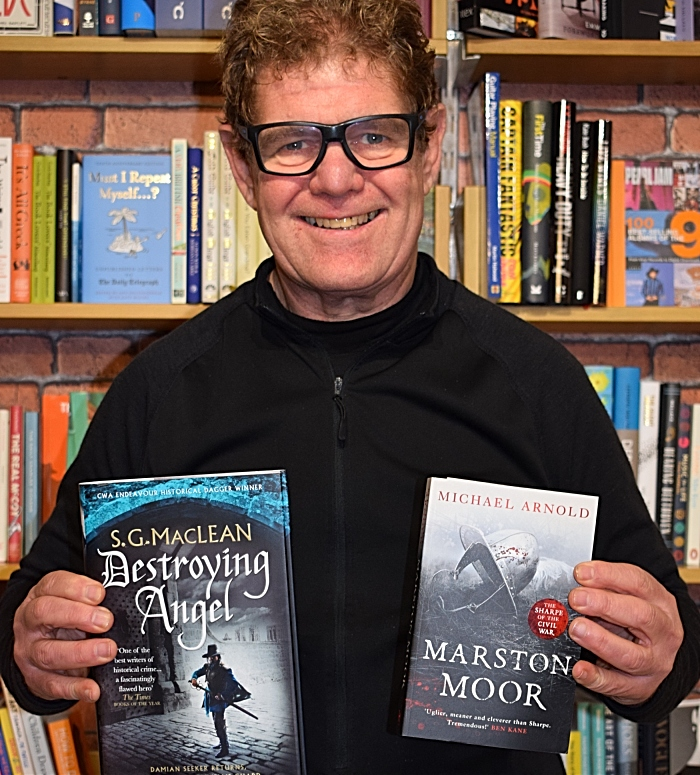 Steve Lawson from Nantwich Book Shop & Coffee holds books from authors attending the event (1)