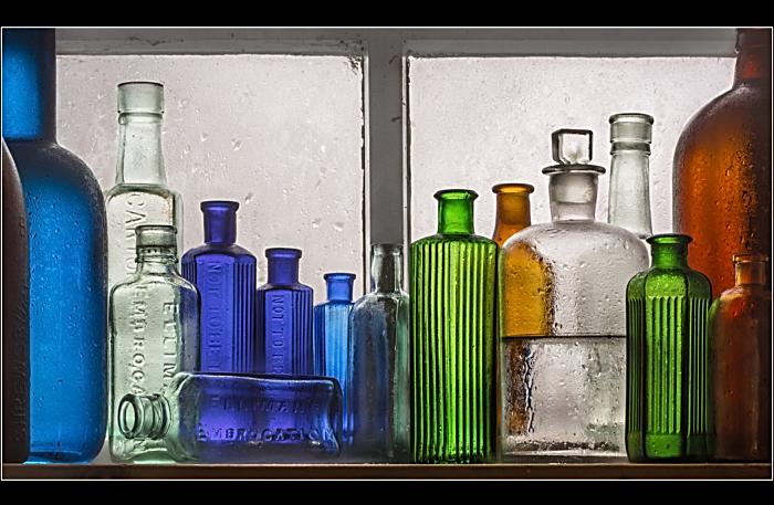 Still Life - Glass Bottles by Wray Douglas