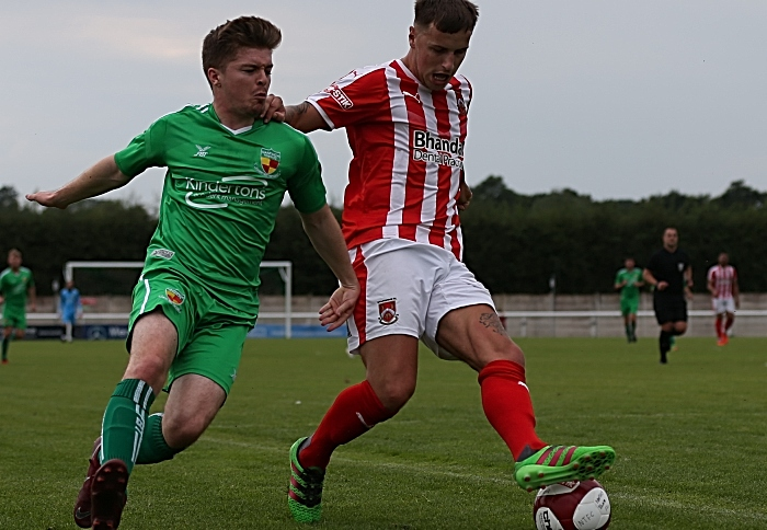 Stourbridge hold off a Nantwich player (1)