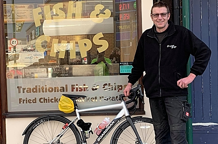 Support crew Rob Simpson with Roy Prices bike outside Crispy Cod in Prestatyn (1)