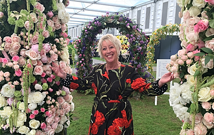 TV gardening Presenter Carol Klein with floral arch (1)