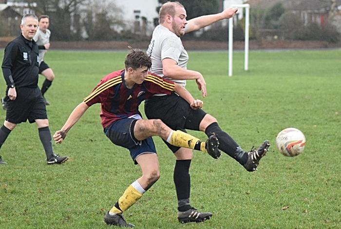 Talbot and Salvador players challenge for the ball (1)
