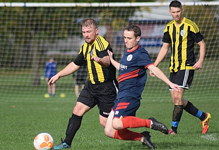 Talbot player prepares to tackle ball from AFC Talbot (1)