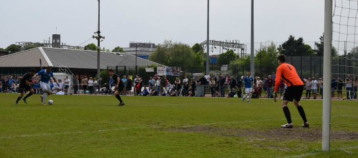 Team Carl attack the goal - Everall Derby charity game
