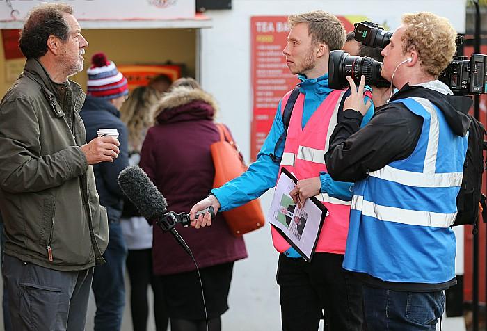 The FA film crew talk to a Dabbers fan