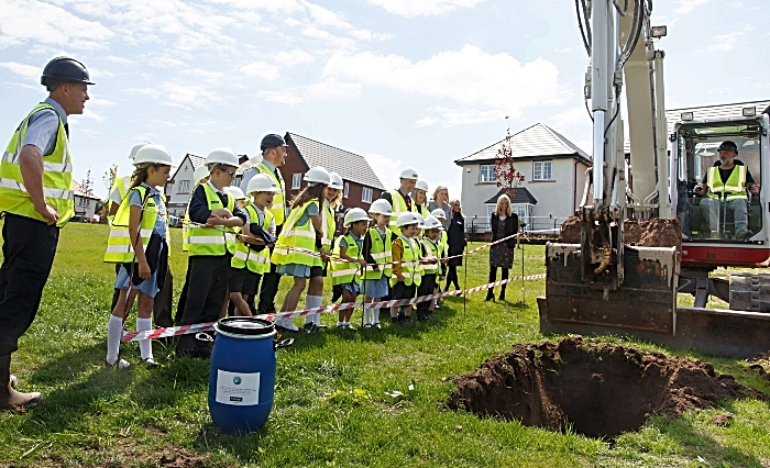 The team from Bloor Homes Wistaston Brook with staff and children from Wistaston Church Lane Academy as they prepare to bury the time capsule (1)