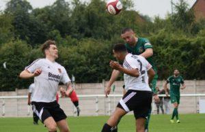 Theo Stair heads the ball forwards against Stourbridge