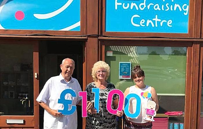 hospice - Tony and Margaret Woods present the money raised to Loren Miller
