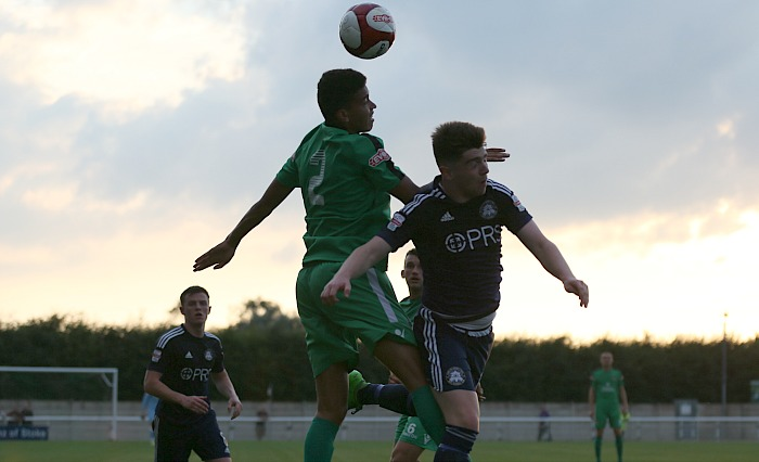 Troy Bourne wins a header in the first half close to sunset